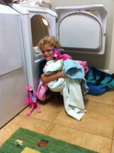 Tyson doing laundry for Mom for Mother's Day